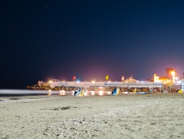 Couples on beach, under stars