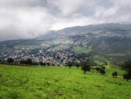 houses in valley under clouds
