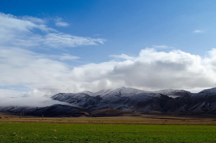 Clean Air in green farm and snowy mountain