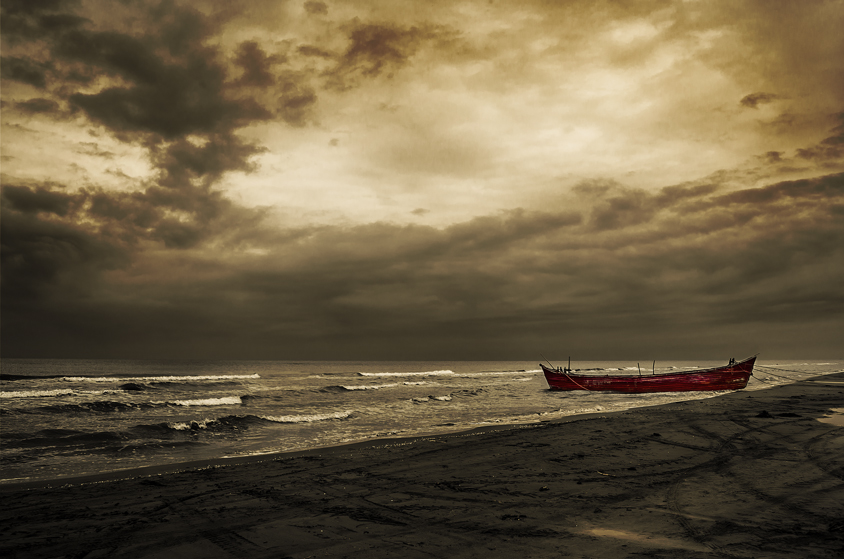 lonely boat on the beach of behshahr
