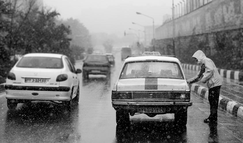 Tehran Taxi in snowy day
