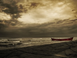 Alone boat on the beach