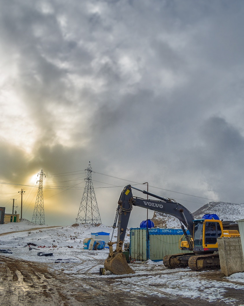 Excavator in Snowy mountains