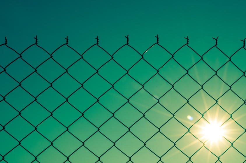 fence and sun